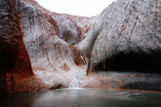 RAIN! Water falls on Uluru.