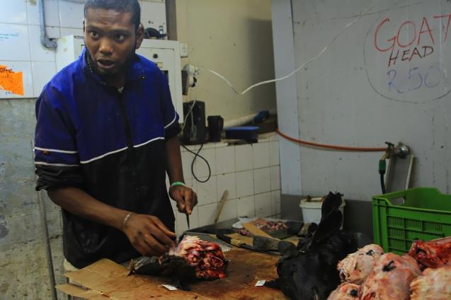 Skinning a goat head